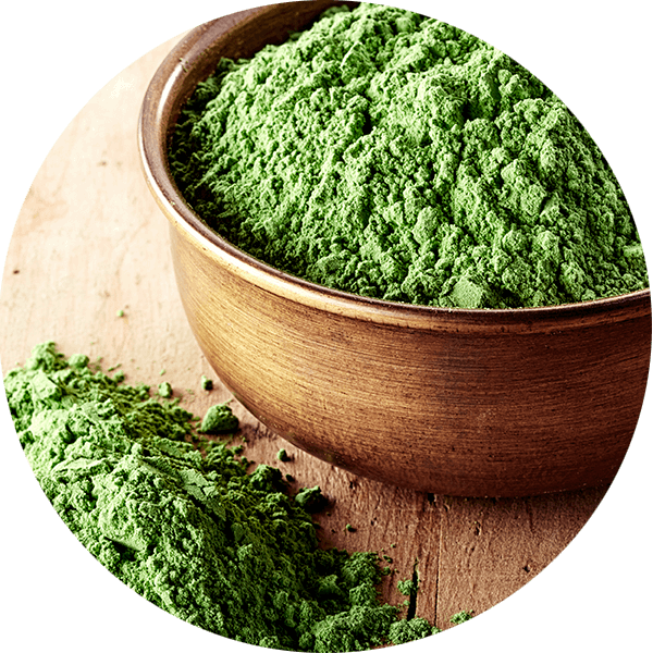 greens powder in wooden bowl