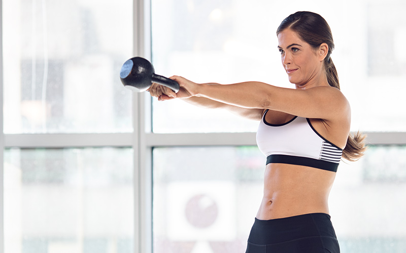 Woman Kettlebell Swing Workout